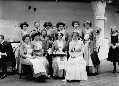 negative; glass plate - Suffragettes working as 'tea-girls' at The Women's Exhibition, Knightsbridge